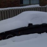 snow covered porsche 944