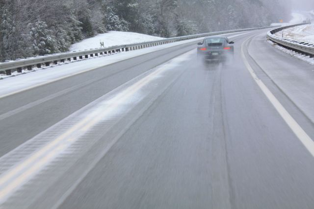 porsche 911 c4s snowy road