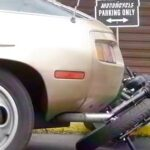 porsche 928 hits bike